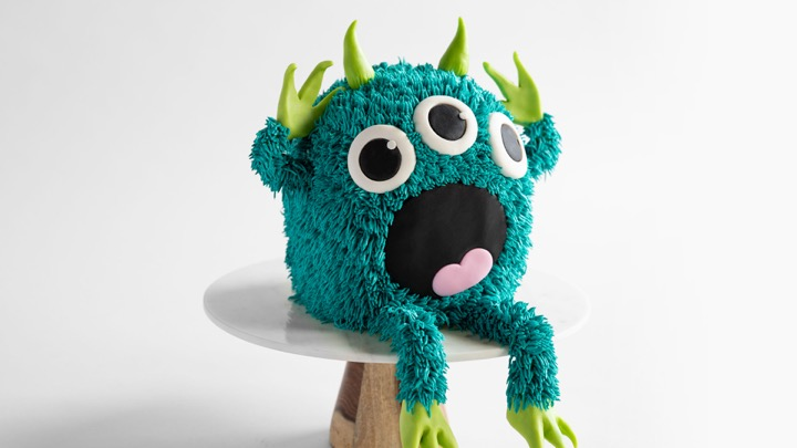Finish up with a mashup of the Crying Onion and Mini Monster Cake! Sculpt and decorate a monster of your own with fur-like buttercream and fondant limbs and horns.